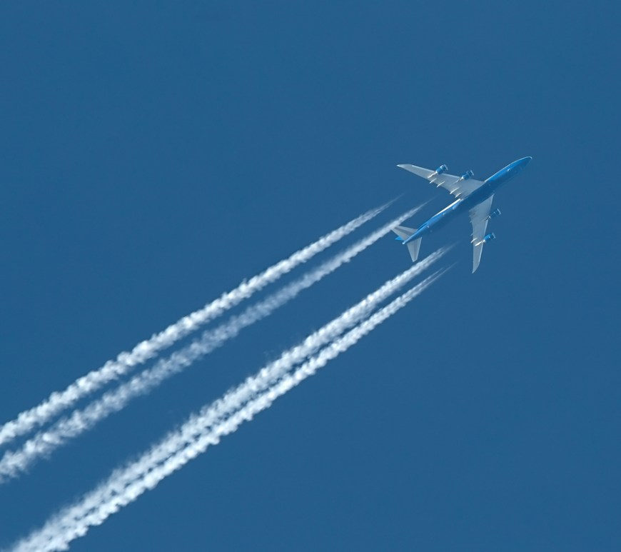 Plane at cruising altitude against blue sky