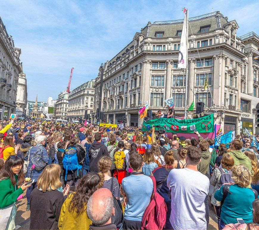 Extinction Rebellion protests in London, April 2019. A big crowd of people gathered around Oxford Circus