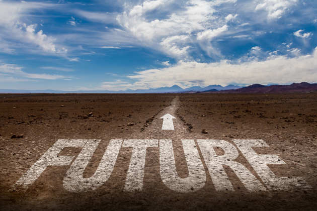 Road leading to the horizon in the desert or similar with the word future and an arrow