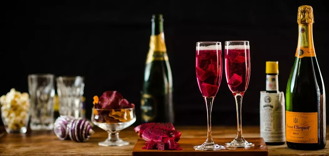 Classic Champagne Cocktail Recipe with a Tropical Fruit Twist. Copyright © 2017 Terence Carter / Grantourismo. All Rights Reserved.