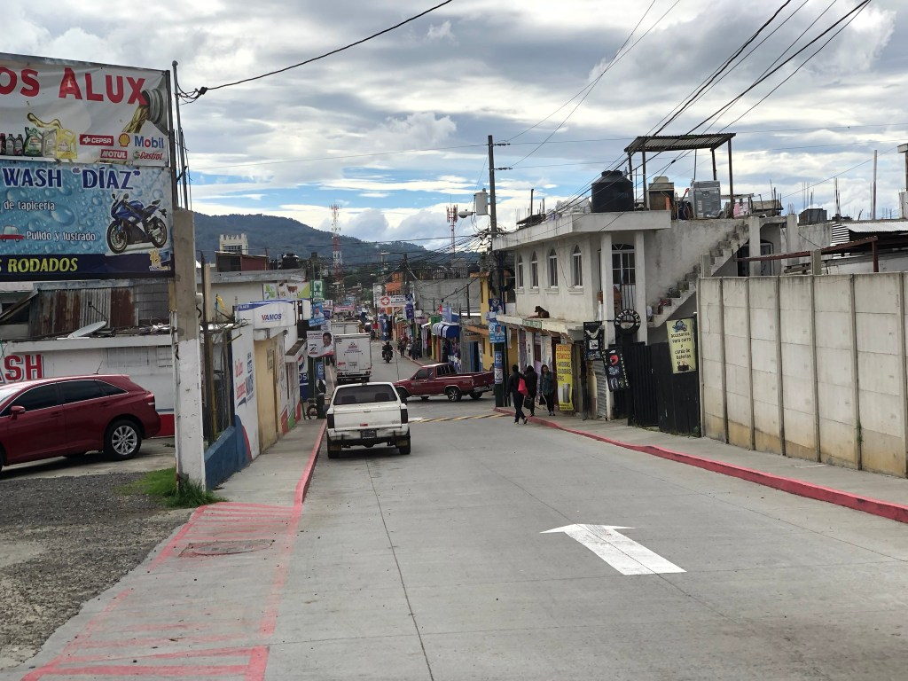 Photo taken down a side street from shuttle in a town outside of Guatemala City.