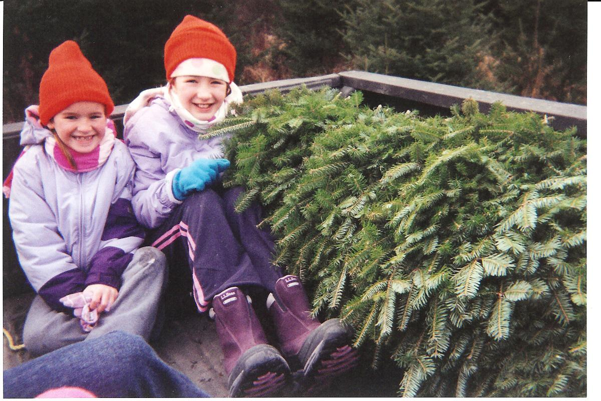 Fiona and Olivia on the truck with the tree