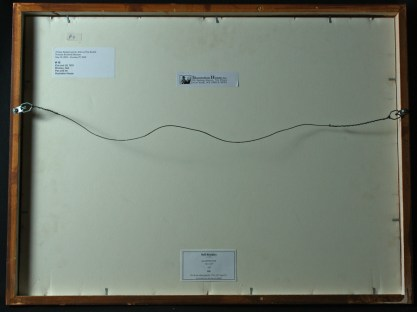 verso view with previous exhibit labels
