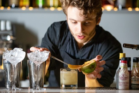 A picture of a Bartender making a drink at Artson