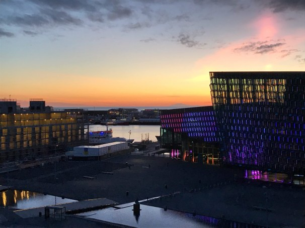 sunset summer view of Harpa from Sky Bar