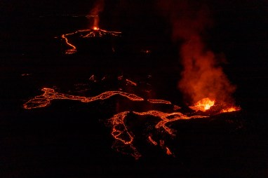 The original Geldingadalsgos eruption, the second fissure and the city lights in the distance. Photo by Art Bicnick