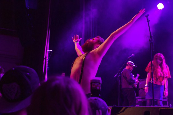 Lead singer of Berndsen, topless, raising his skinny fists to the heavens like antennas to the sky
