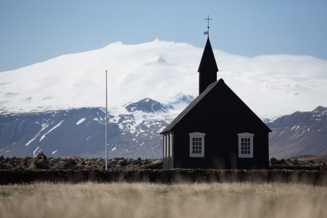 Picturesque view with the church and Snæfellsjökull