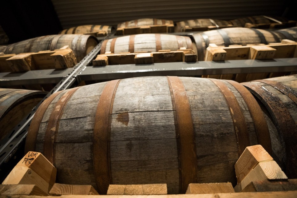 Whiskey Barrels stacked from floor to ceiling