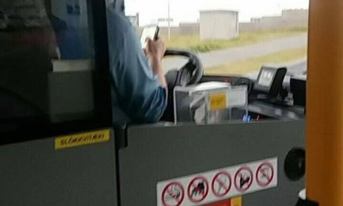 Local Bus Driver Too Busy On His Phone Drives Past School & Misses Stop