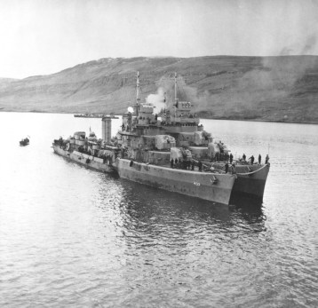 USS Kearny at Reykjavík, Iceland, 19 Oct 1941, two days after she was torpedoed by the German submarine U-568. USS Monssen is alongside. Note the torpedo hole in Kearny_s starboard side amidships