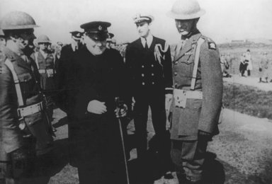 Winston Churchill visiting US Marines on Iceland, 16 Aug 1941_ note Ensign Franklin Roosevelt, Jr. and Lieutenant Colonel Oliver Smith also present