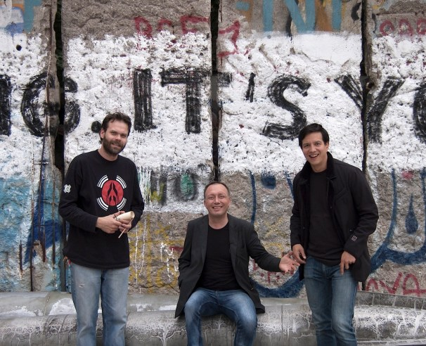 Jóhann Sigmarsson and two of his coworkers in Berlin. Pieces of Berlin Wall in background.