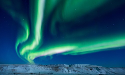 Northern Lights Illuminate Full Moon's Night Sky