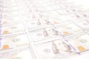 Bright Dollar Bills Stock Photo