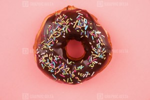 Chocolate doughnut on pink background