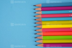 Color Pencils on Blue Stock Image