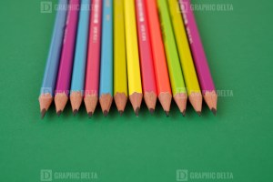 Color Pencils on Green Stock Image