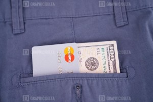 Mastercard and dollars in pocket