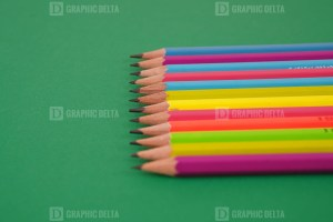 Set of Pencils on Green Background