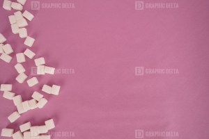 Sugar cubes on rose background stock photo