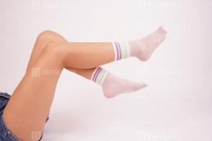 Young female wears fashionable white socks