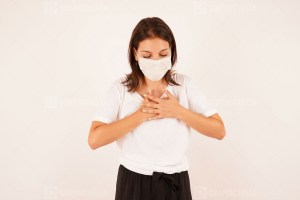 Woman in medical mask coughing