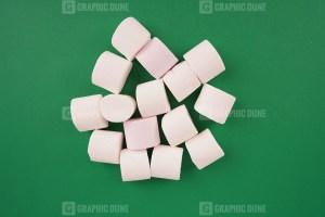 White marshmallow on green background stock photo