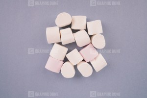 White marshmallow on purple background stock photo