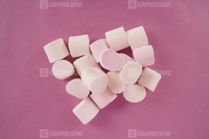 White marshmallow on purple background