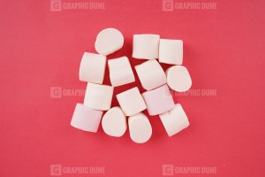 White marshmallow on red background stock photo