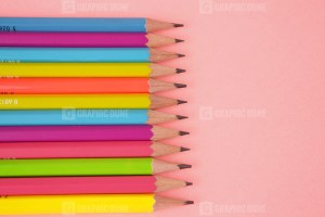 Colorful pencils on color background