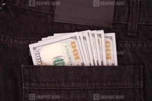 US dollars in jeans pocket stock image