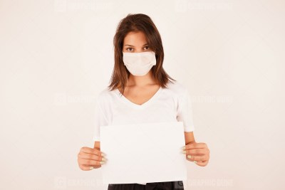 Woman in medical mask holding sign