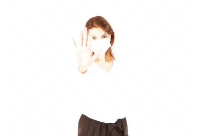 Woman in medical mask making stop gesture