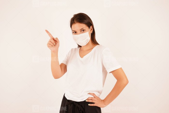 Woman in medical mask pointing finger