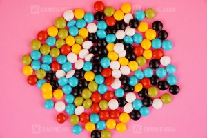 Candies isolated on pink background stock photo