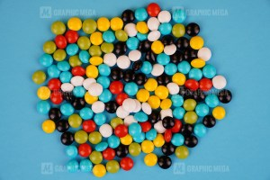 Colorful candy isolated on blue background stock photo