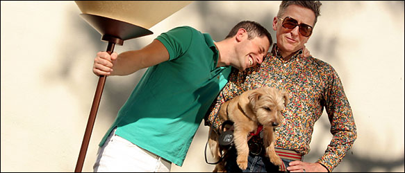 Jonathan Adler, left, with Simon Doonan, Liberace the terrier and a lamp at a Florida antiques store.