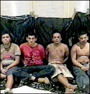 An image from a video sent to a newspaper shows four Mexican hired killers said to have been beaten by rivals.