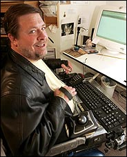 Steven Singley, a quadriplegic, works at home
