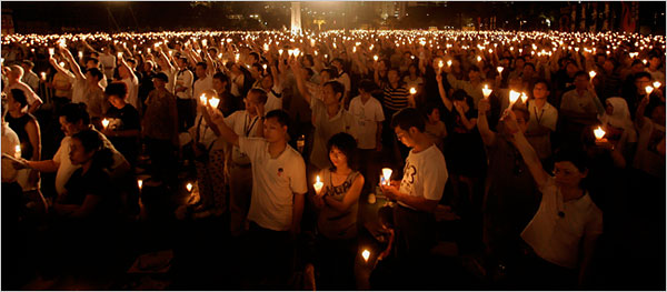 A candlelight vigil in Hong Kong to mark the 18th anniversary of the military crackdown on the Tiananmen Square demonstrations, source: NY Times, Bobby Yip/Reuters
