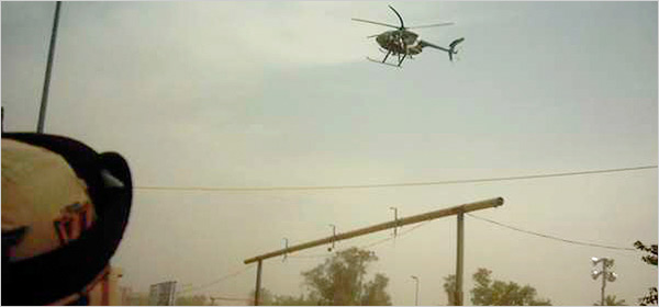 A 2005 photo showed a Blackwater helicopter releasing CS gas at a checkpoint in Baghdad. (Capt. Kincy Clark)