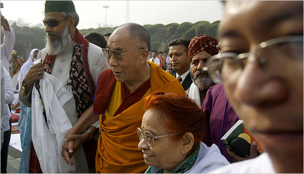 The Dalai Lama arrived Saturday at a memorial to Gandhi in New Delhi for a public interfaith meeting to pray for people killed in recent uprisings in the Tibet area.