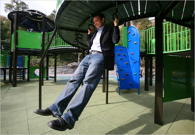 NY Parks Dept. playground designer Alexander Hart using his creation.