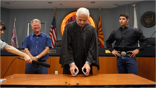 Cave Creek, Arizona, Judge George Preston, shuffles cards to breal a deadlock between Thomas McGuire, left, and Adam Trenk.  New York Times photo by Joshua Trent