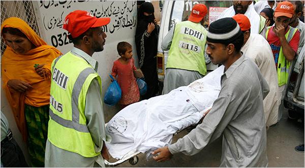Reuters: Rescue workers from Edhi Foundation carry victims