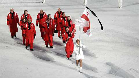 The delegation from Georgia entered with black scarves and a black band around their right bicep to honor their luge athlete, Nodar Kumaritashvili, who died earlier in the day.