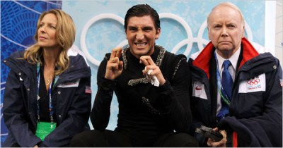 "Evan Lysacek in the ""kiss and cry"" area with his coach Frank Carroll"