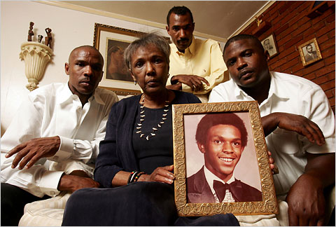 In 2008, Ruby Session held a photograph of her son Tim Cole after DNA testing proved that he had not committed the rape he was convicted of in 1986. He died in prison before his exoneration.